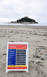 Lifeguard information on Marazion beach, Cornwall. St Michael's Mount in the background. UK