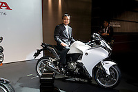 Honda CEO Takanobu Ito poses on a motorbike at the Tokyo motorshow. October 2009.