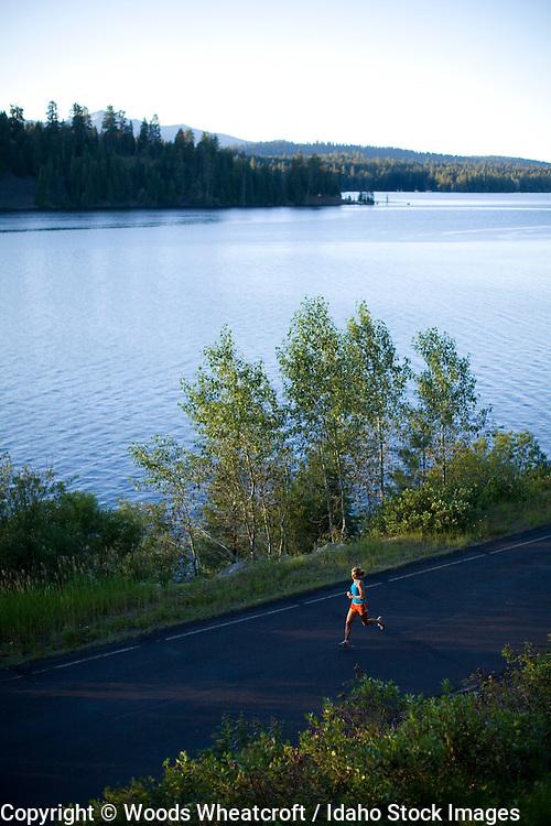 Jill Flyckt running near Payette Lake in McCall, Idaho