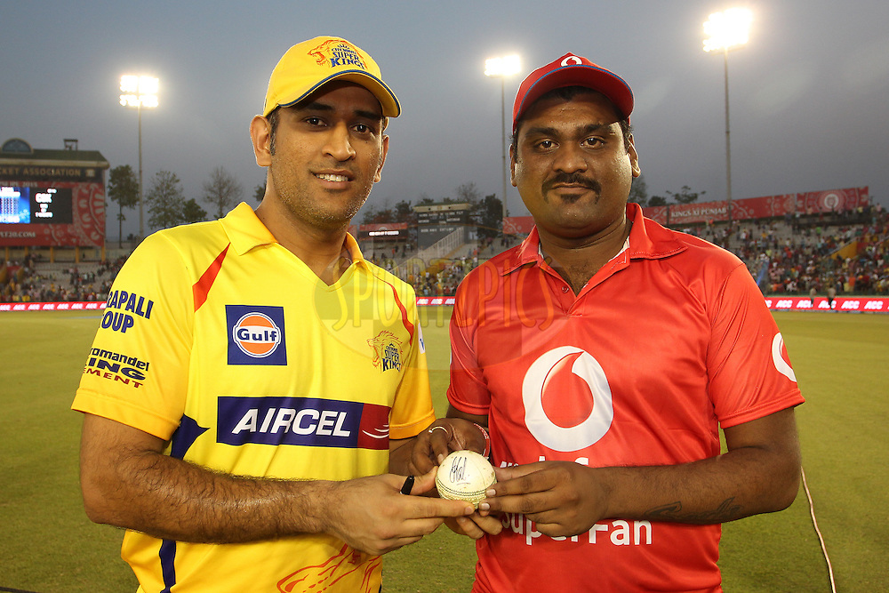 Chennai Super Kings Captain MS Dhoni and the Vodafone Superfan  during match 53 of the Pepsi IPL 2015 (Indian Premier League) between The Kings XI Punjab and The Chennai Super Kings held at the Punjab Cricket Association Stadium in Mohali, India on the 16th May 2015.<br /> <br /> Photo by:  Shaun Roy / SPORTZPICS / IPL