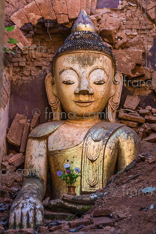 Buddha statue hiding in the ruins of the Shwe Inn Dein Pagoda at Inle Lake Shan state in Myanmar (Burma)