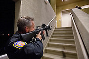 Officer Joe Marks provides cover for his partner Terry Dobrosky who is at the top of the stairs. The two officers were searching an apartment complex for an armed robbery suspect. The suspect was never found. Dec. 7, 2011. Oxnard, Calif. (Photo by Gabriel Romero ©2011)