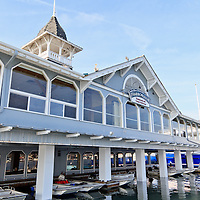 Photo of Balboa Pavilion at 400 Main Street, Newport Beach, CA  92661. Balboa Pavilion is a landmark built in 1906 and now houses several businesses including Harborside Restaurant. Newport Beach is a beach community along the Pacific Ocean in Orange County Southern California.