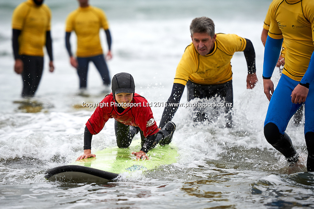 Joel catches a wave as part of the Flight Centre Foundation Halberg Surf Day, Lyall Bay, Wellington, New Zealand. Saturday 12 March 2016. Copyright Photo: Mark Tantrum/www.Photosport.co.nz