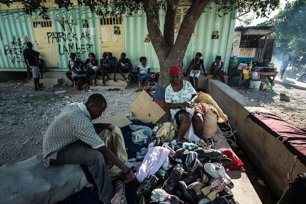 ANSE-A-PITRE, HAITI -NOVEMBER 23, 2015: Vendors sell goods in the street on the Haitian side of the border crossing between Anse-A-Pitre, Haiti and Pedernales, Dominican Republic. The same vendors used to regularly cross into a binational market on the Dominican side of the border, however Dominican officials closed the market in effort to prevent the spread of Cholera.  They've held shop in the streets ever since, instead.  PHOTO: Meridith Kohut for The New York Times