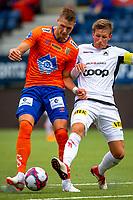 1. divisjon fotball 2018: Aalesund - Åsane (1-0). Aalesunds Holmbert Fridjonsson (t.v.) i duell med Jonas Hestetun i kampen i 1. divisjon i fotball mellom Aalesund og Åsane på Color Line Stadion.