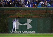 October 11, 2017 - Chicago, IL, USA - Chicago Cubs left fielder Ian Happ watches the Washington Nationals' Michael Taylor grand slam in the eighth inning during Game 4 of the National League Division Series at Wrigley Field in Chicago on Wednesday, Oct. 11, 2017. The Nationals won, 5-0, to force a decisive fifth game. (Credit Image: © Nuccio Dinuzzo/TNS via ZUMA Wire)