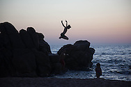 Corsica, Propriano area, Capo Laurose beach  young boy  playing
