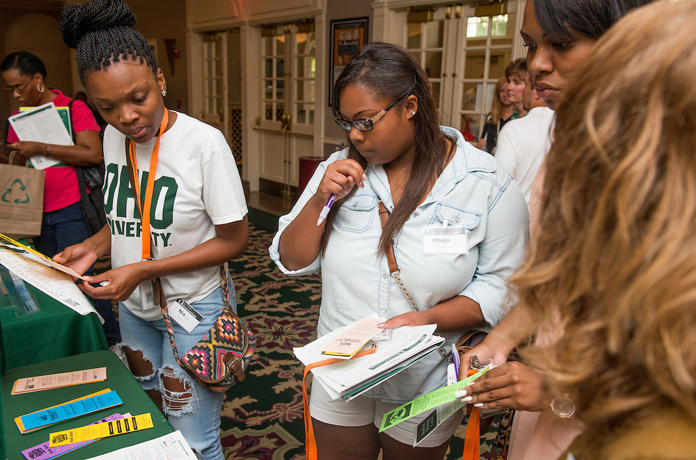 Incoming freshman and parents during Bobcat Student Orientation 2013 browse in the lobby of Templeton-Blackburn Alumni Memorial Auditorium a few campus activities to help students become more involved on July 23, 2013. Photo by Elizabeth Held