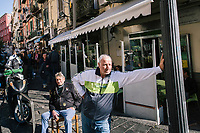 "NAPLES, ITALY - 8 NOVEMBER 2018: Two men are seen here in Montesanto, a neighborhood in the historical center of Naples, Italy, on November 8th 2018.<br /> <br /> The ""citizens' wage"", a welfare policy championed by the governing 5-Star Movement, is designed to lift 5 million Italian out of poverty. The ""citizens' wage"" will cost 10 billion euros next year, the most expensive item in a big-spending budget which itself has raised concerns in the European Union that Italy could be sowing the seeds of a financial crisis."