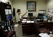 "A Baltimore Ravens cheerleader hopeful warms up in an office before taking to the stage during an event called ""Making the Cut"" to select the 2011 Baltimore Ravens cheerleaders in Baltimore, Maryland, March 26, 2011."