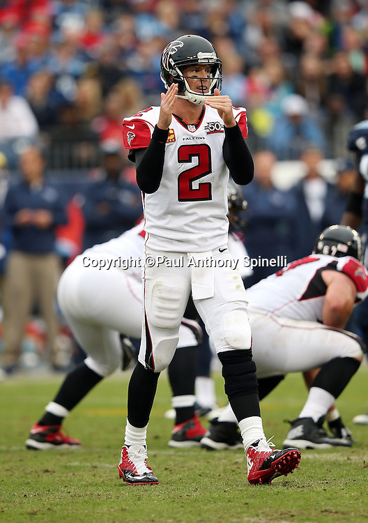 Atlanta Falcons quarterback Matt Ryan (2) calls a time out during the 2015 week 7 regular season NFL football game against the Tennessee Titans on Sunday, Oct. 25, 2015 in Nashville, Tenn. The Falcons won the game 10-7. (©Paul Anthony Spinelli)