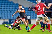 George Taylor (#12) of Edinburgh Rugby tries to break free from the tackle of Paul Abadie (#9 of SU Agen Rugby during the European Rugby Challenge Cup match between Edinburgh Rugby and SU Agen at BT Murrayfield, Edinburgh, Scotland on 18 January 2020.