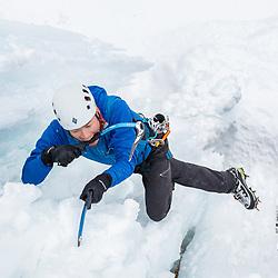 Takeshi Tani ice climbing Pilsner Pillar, WI6, in Field, BC