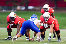 24 September 2011: Keenan Wimbley and Cody White line up opposite Zacharia Bowers during an NCAA football game between the South Dakota State Jackrabbits (SDSU) and the Illinois State Redbirds (ISU) at Hancock Stadium in Normal Illinois.