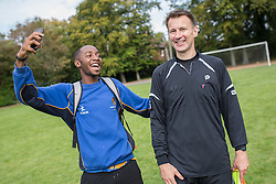 © Licensed to London News Pictures . 28/09/2014 . Birmingham , UK . Birmingham University student Jarred Isles (19 , right) , who is studying Policy , Politics and Economics and describes himself as a fan of Jeremy Hunt , poses for a selfie with Jeremy Hunt after the match . Conservative Party vs Journalists football match at a Birmingham University football pitch , at the start of the conference . The 2014 Conservative Party Conference in Birmingham . Photo credit : Joel Goodman/LNP