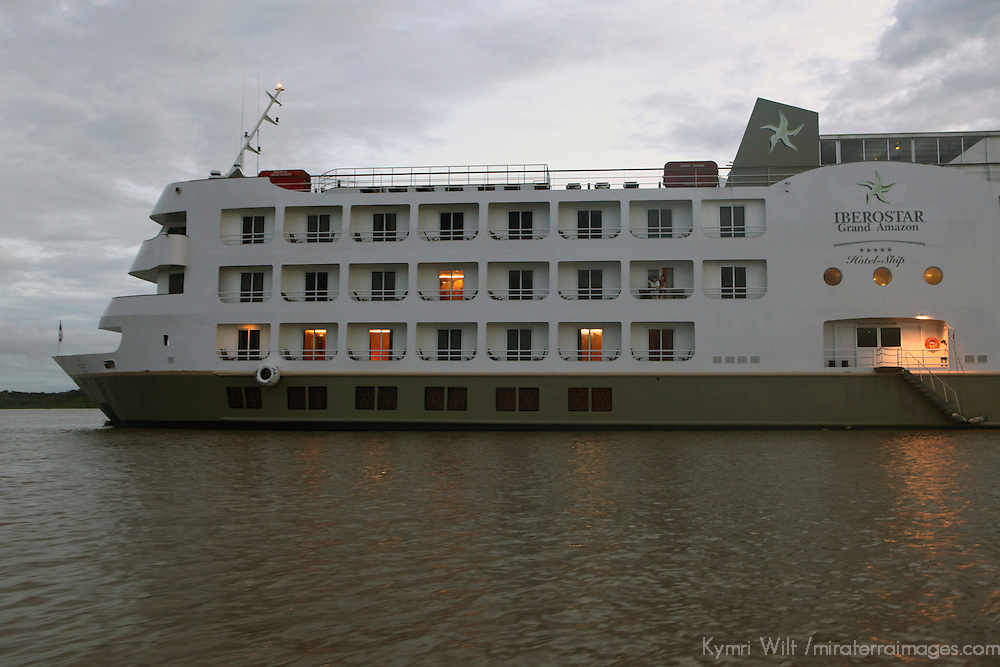 South America, Brazil. Amazon River. Iberostar Grand Amazon at dusk on river.