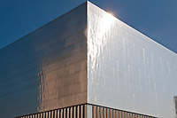 Incineration power plant in Zürich, Switzerland. A metal clad building shining in the sun.