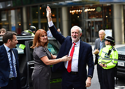 """RETRANSMITTED WITH ADDITIONAL INFORMATION Labour leader Jeremy Corbyn is greeted by hiis Office Director Karie Murphy as he arrives at Labour Party HQ in Westminster, London, after he called on the Prime Minister to resign, saying she should """"go and make way for a government that is truly representative of this country""""."""