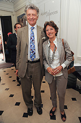 The HON.WILLIAM SHAWCROSS and his wife OLGA POLIZZI at a party to celebrate the launch of Page One an online guide to London's 100 most rewarding restaurants held at the Halcyon Gallery, Bruton Street, London on 7th July 2010.