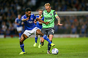 AFC Wimbledon midfielder Mitchell Pinnock (11) tussles with Ipswich Town defender Janoi Donacien (2) during the EFL Sky Bet League 1 match between Ipswich Town and AFC Wimbledon at Portman Road, Ipswich, England on 20 August 2019.