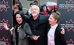 "Edinburgh International Film Festival, Sunday 26th June 2016<br /> <br /> Stars turn up on the closing night gala red carpet for the World Premiere of ""Whisky Galore!""  at the Edinburgh International Film Festival 2016<br /> <br /> Composer Patrick Doyle with his daughters Abigail (dark hair) and Nuala (blonde)<br /> <br /> (c) Alex Todd 