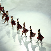 Members of The Haydenettes  perform a synchronized skate during the Smucker's Skating Spectacular at the TD Garden on January 12, 2014 in Boston, Massachusetts.