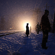 A Marine is silhouetted by the Toys for Tots Holiday Train as it approaches Delanson, NY on December 5, 2009 to deliver gifts to children and<br /> families in need.