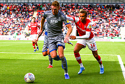 Cian Bolger of Lincoln City shields the ball from Carlton Morris of Rotherham United - Mandatory by-line: Ryan Crockett/JMP - 10/08/2019 - FOOTBALL - Aesseal New York Stadium - Rotherham, England - Rotherham United v Lincoln City - Sky Bet League One