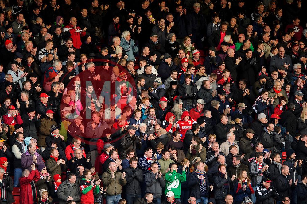 Bristol City fans celebrate after a goal during the first half of the match - Photo mandatory by-line: Rogan Thomson/JMP - Tel: Mobile: 07966 386802 - 29/12/2013 - SPORT - FOOTBALL - Ashton Gate, Bristol - Bristol City v Stevenage - Sky Bet League One.
