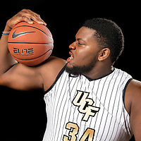 Center Justin McBride poses during the Knights media day event at the University of Central Florida CFE Arena on Monday, October 7, 2013 in Orlando, Florida. (AP Photo/Alex Menendez)