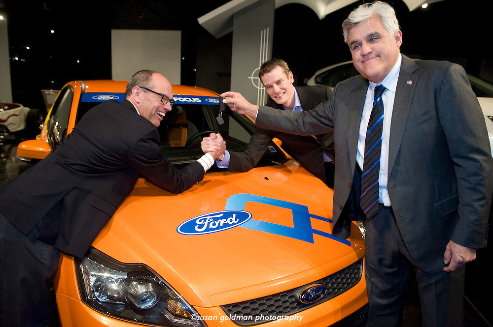 "Television host and car enthusiast Jay Leno, right, holds the key to the Ford Focus Electric Vehicle as Matt VanDyke, Ford director of U.S. marketing and communications, center, and Leslie Kendall , curator at the Petersen Automotive Museum, arm wrestle over the key to the car being donated to the museum, in Los Angeles. The car, Ford's first ever all electric passenger car, was featured on the Green Car Challenge on the ""Jay Leno Show"".  Photo/Ford, Susan Goldman."