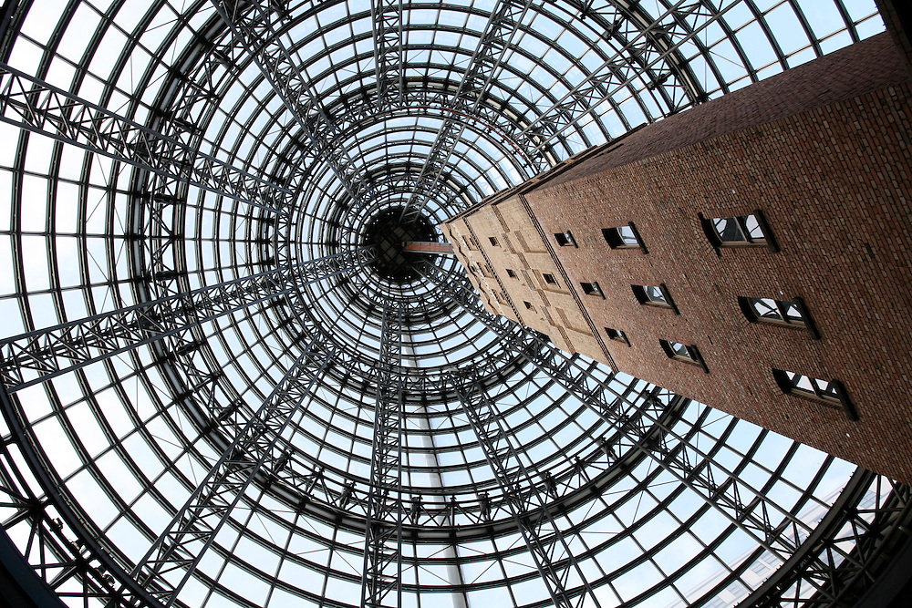 The impressive shot tower and glass roof of the atrium covering Melbourne Central , a giant shopping complex, Melbourne, Australia, July 01, 2007. Credit:SNPA / Rob Tucker