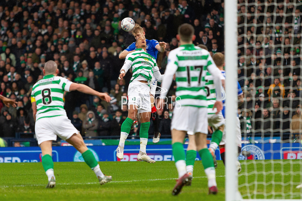 Filip Helander of Rangers FC gets to the ball ahead of Christopher Jullien of Celtic FC during the Betfred Scottish League Cup Final match between Rangers and Celtic at Hampden Park, Glasgow, United Kingdom on 8 December 2019.