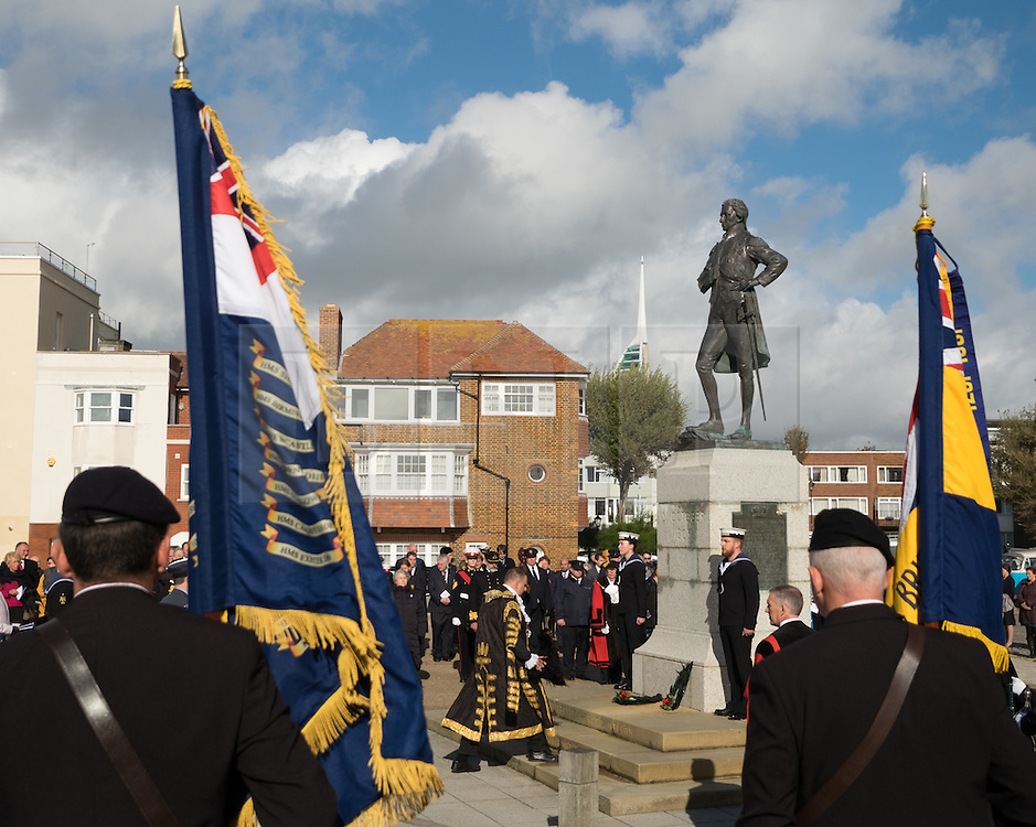 © Licensed to London News Pictures. 16/10/2016. Portsmouth, Hampshire, UK. Lord Mayor of Portsmouth, Councillor DAVID FULLER lays a wreath at the statue of Lord Nelson in Old Portsmouth. Lord-Lieutenant of Hampshire, NIGEL ATKINSON and Lord Mayor of Portsmouth, Councillor DAVID FULLER, have taken part in the annual Seafarer's Service held at Portsmouth Cathedral, and the laying of wreaths at the statue of Lord Nelson. The service is held annually, on the first Sunday prior to the anniversary of the Battle of Trafalgar, 21st October, and remembers those who have lost their lives at sea, and also commemorates the life of Lord Horatio Nelson. Photo credit: Rob Arnold/LNP