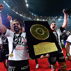 Yoann Huget and Maxime Medard of Toulouse celebrates the victory with the trophy during the Top 14 Final match between Toulouse and Clermont at Stade de France on June 15, 2019 in Paris, France. (Photo by Anthony Dibon/Icon Sport)