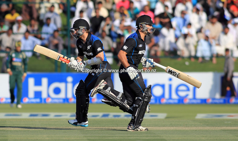 Pakistan vs New Zealand, 19th December 2014. Dean Brownlie and Kane Williamson run between wickets in the 5th ODI in Abu Dhabi