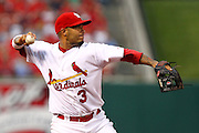 29 June 2010: St. Louis Cardinals shortstop Felipe Lopez (3) fields a ground ball hit to short and throws to first after a Diamondback batter made contact during the Cardinals' game against Arizona  at Busch Stadium in St. Louis, Missouri. The Cardinals would win 8-0 after nine.