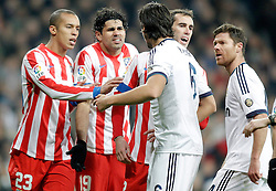 01.12.2012, Estadio Santiago Bernabeu, Madrid, ESP, Primera Division, Real Madrid vs Atletico Madrid, 14. Runde, im Bild Real Madrid's Sami Khedira and Xabi Alonso argue Atletico de Madrid's Miranda, Diego Costa and Diego Godin // during during the Spanish Primera Division 14th round match between Real Madrid CF and Club Atletico de Madrid at the Estadio Santiago Bernabeu, Madrid, Spain on 2012/12/01. EXPA Pictures © 2012, PhotoCredit: EXPA/ Alterphotos/ Alvaro Hernandez..***** ATTENTION - OUT OF ESP and SUI *****
