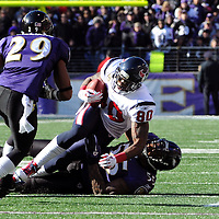 15 January 2012: Houston Texans wide receiver Andre Johnson (80) in action against Baltimore Ravens outside linebacker Terrell Suggs (55) in the Divisional Playoff at M&T Bank Stadium in Baltimore, MD. The Ravens defeated the Texans 20-13 to advance to the AFC Championship game..