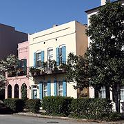 A portion of Rainbow Row, a row of private residences painted a series of eye-catching colors by their owners. Charleston, SC, USA