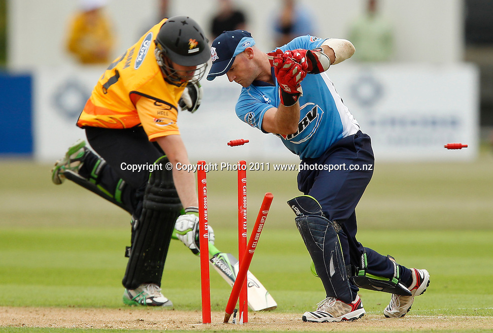Harry Boam of the Firebirds is run out by Gareth Hopkins of the Aces during the HRV Cup Cricket Twenty-20,  Auckland Aces v Wellington Firebirds, Colin Maiden Park Auckland, Sunday 18 December 2011. Photo: Simon Watts/www.photosport.co.nz
