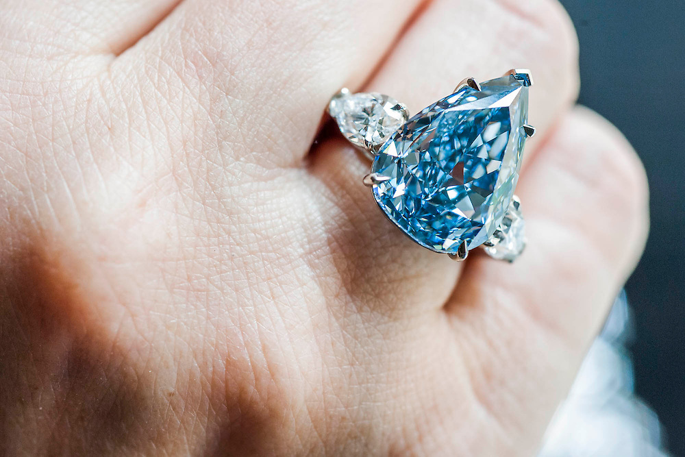 Christie's show off major pieces to be autioned in their Magnificent Jewels sale in Geneva. These include: the Blue (pictured) - the largest flawless vivid blue diamond in the world, estimate $21-25m; the Rajah - a brilliant cut diamond of 26.14 carats, est $3-5m; and the Ocean Dream - the largest fancy vivid bluee-green diamond. King Street, London, UK.