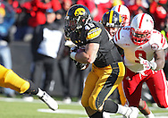 November 23 2012: Iowa Hawkeyes running back Mark Weisman (45) on a run as Nebraska Cornhuskers defensive end Jason Ankrah (9) gives chase during the second half of the NCAA football game between the Nebraska Cornhuskers and the Iowa Hawkeyes at Kinnick Stadium in Iowa City, Iowa on Friday November 23, 2012. Nebraska defeated Iowa 13-7 in the Heroes Game on Black Friday.
