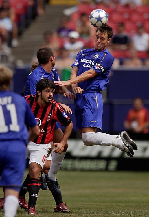 Chelsea's John Terry heads a ball away from AC Milan's Genaro Gattuso during a match.   (Photo by Robert Falcetti). .