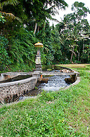 Small temple on a bridge over a canal near Ubud, Bali, Indonesia