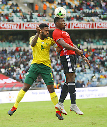 Durban 08-09-18 Thulani Hlwatshway (left) of Bafana Bafana fighting for the ball withAhmed Almaghasi  of Libya during the African Nations qualifier against Libya at Moses Mabhida stedium<br /> Picture Bongani Mbatha African News Agency (ANA)