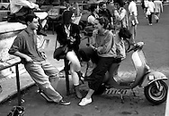 Roma  1998.Ragazzi con la vespa in Piazza Farnese.Young people with the vespa in Piazza Farnese