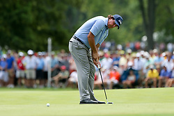 August 9, 2018 - St. Louis, Missouri, United States - Phil Mickelson putts during the first round of the 100th PGA Championship at Bellerive Country Club. (Credit Image: © Debby Wong via ZUMA Wire)