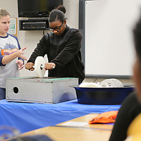 Jessica Sinak, a tire engineer with Cooper Tire in Tupelo, has Kalasia James, an eleventh grader at Tupelo High School, demonstrate the uniformity of a tire by using different types of wheels to explain balance, wear and rotation to Tupelo High School Career and Technical Center Students on Friday. Cooper Tire held different stations in the Career Technical Center to give students a hands on learning experience about the tire manufacturing process, how to care for tires and about the different types of career opportunities available at Cooper Tire.